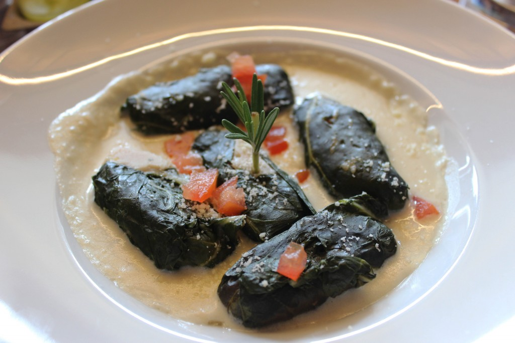 Capuns, a dish with Swiss chard rolls and sausage in a cream sauce